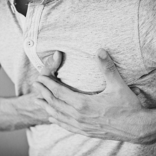 Men showing an heartache
